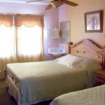 Room With Queen and Twin Bed - Cable TV, The Bathroom, Shower, Kitchen Down Hall, European Style.